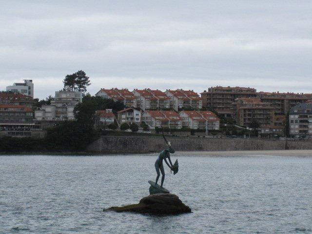 Statue in the water that looks like some sea fairy.